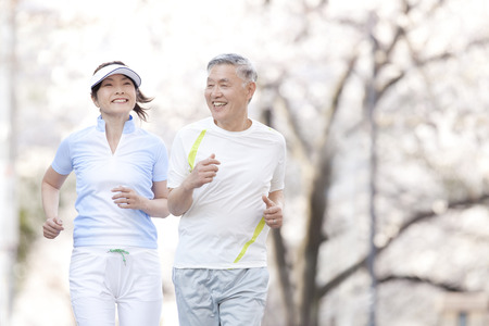 old asian: Senior couple jogging
