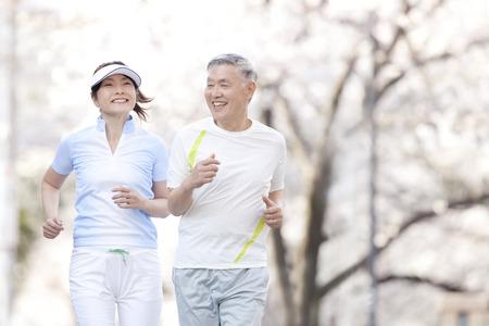 asian wife: Senior couple jogging