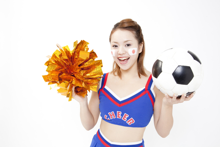 urge: Cheerleader smile soccer ball