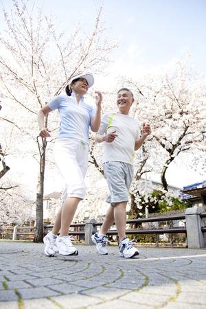 シニア カップル ジョギング 写真素材