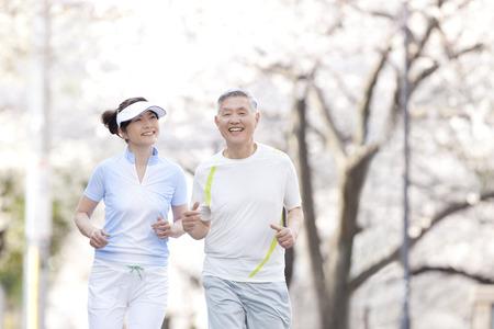 asia nature: Senior couple jogging