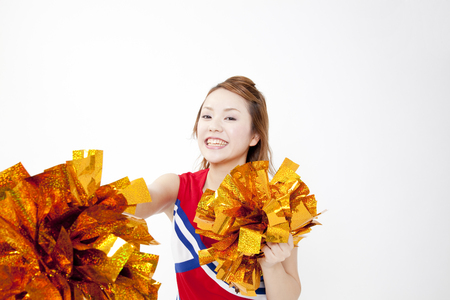 gratification: Cheerleader cheer with a smile Stock Photo