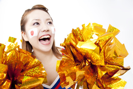urge: Cheerleader cheer with a smile Stock Photo
