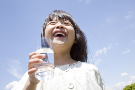 people drinking water: Girl drinking a glass of water