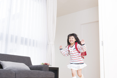Girls running, shoulder school bags