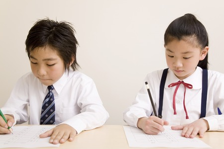 fill in: Elementary school students to fill in the answer sheet Stock Photo