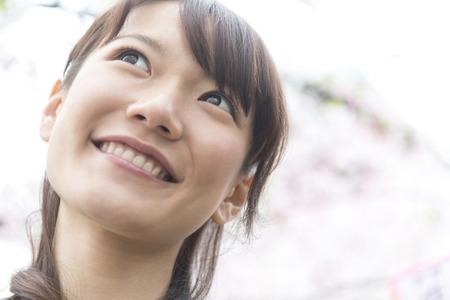Women admire the cherry blossoms