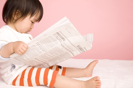 Baby read the newspaper