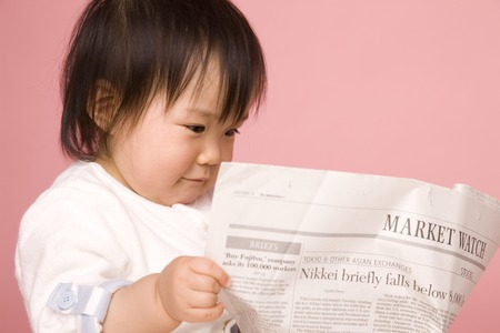 1 person: Baby read the newspaper
