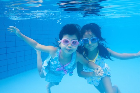 a bathing place: Swimsuits girls swim underwater