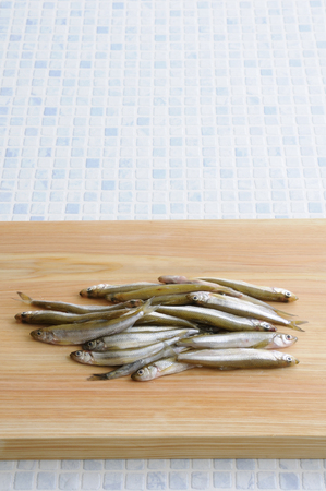 Surf smelt on the cutting board Stock Photo