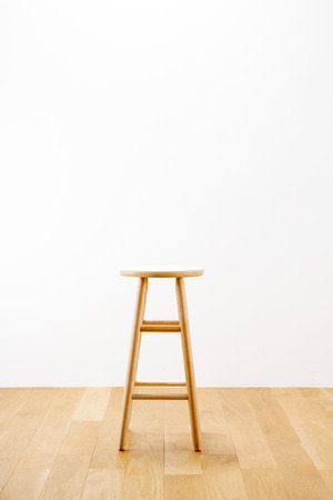 stool: A room with a wood stool