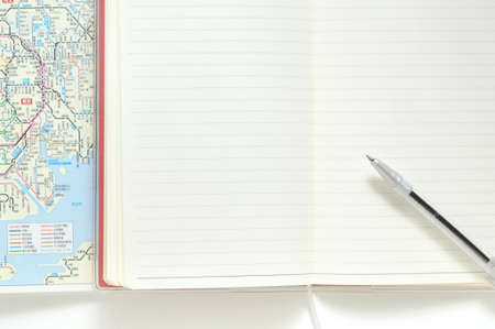 ballpoint: Notebook and ballpoint pens and maps Stock Photo