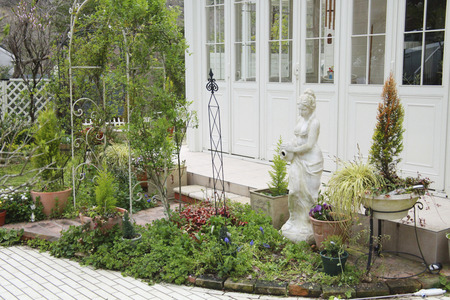 conservatory: Garden with white conservatory