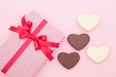 Gift box with heart-shaped chocolate
