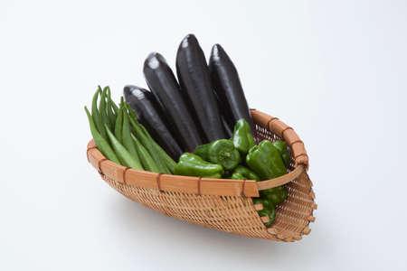 plural number: Summer vegetables with the colander