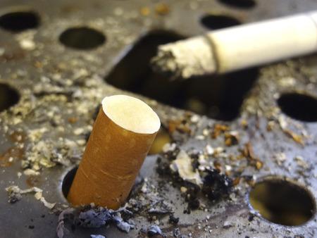 ashtray: Butts ashtray and cigarette
