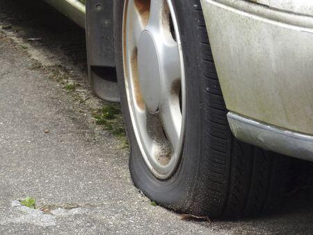 passenger car: Tires punctured passenger car Stock Photo