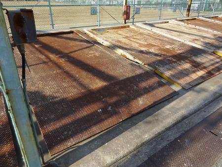 機械式駐車場のトレイの鉄板 写真素材