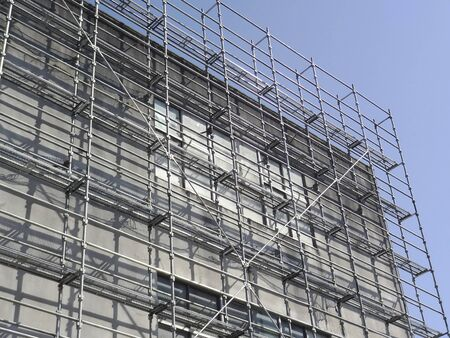 Scaffolding of the building outer wall construction site