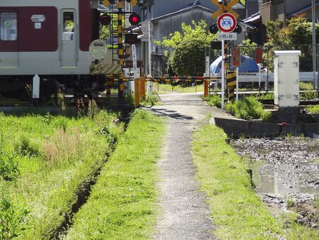 railroad crossing: Footpath and railroad crossing Stock Photo