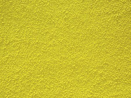 黄色で塗られた建物のモルタル外壁 写真素材