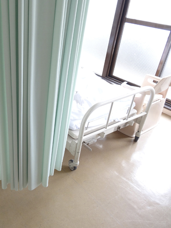 healthcare facilities: Partition curtains and bed of the hospital room