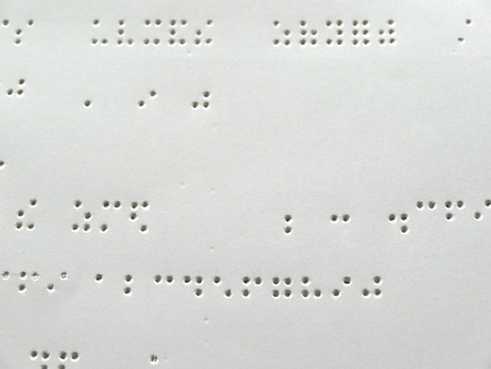 Holes were drilled in the paper in Braille machine Standard-Bild