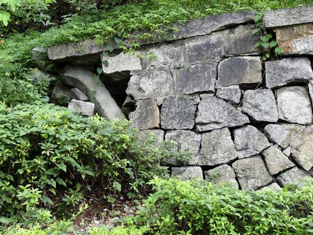 collapsed: Collapsed stone wall Stock Photo