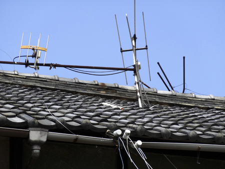 inclination: TV antenna inclination of the private house of the roof Stock Photo