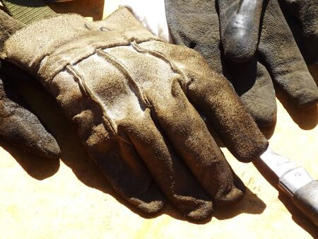 work gloves: Construction workers of leather work gloves Stock Photo