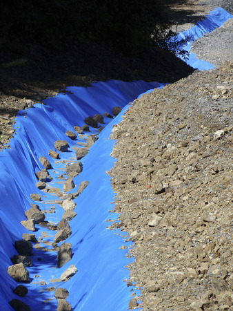 drainage: Temporary drainage ditch made with blue sheet