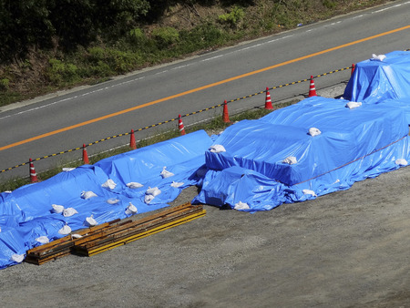 construction materials: Blue sheet was covered in construction materials
