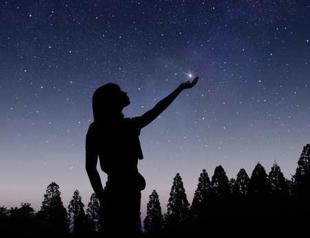 radiancy: Starry sky and female silhouette Stock Photo