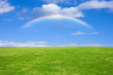 Grassland and blue sky and rainbow