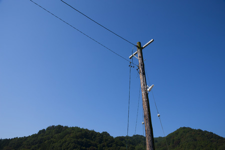 utility pole: Wooden utility pole Stock Photo
