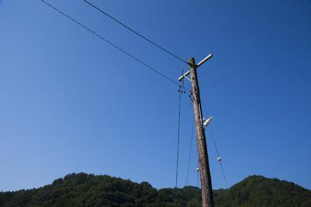 utility pole: Wooden utility pole Stock Photo