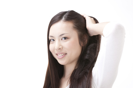 scraping: Woman to increase scraping the hair Stock Photo