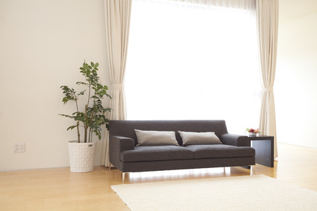 second floor: Sofa placed on the second floor of the Hall Stock Photo