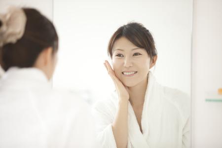 Women look in mirror Stock Photo