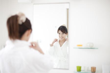 Women look in mirror Banco de Imagens