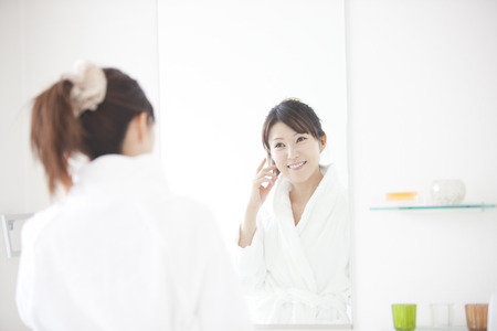 mirror: Women look in mirror Stock Photo
