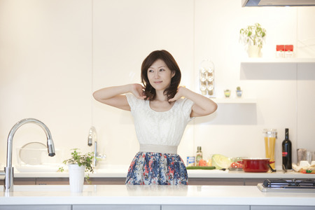 asian house plants: Women stand in the kitchen