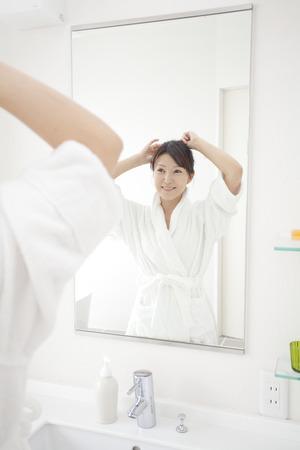 Women look in mirror 写真素材