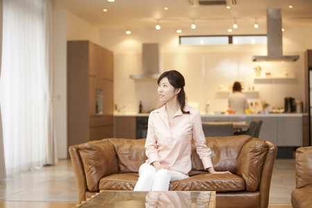 living being: Women relax sitting on the couch