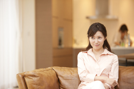 loosen up: Women relax sitting on the couch