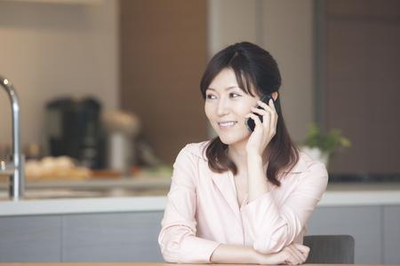 woman on phone: Woman in phone Stock Photo