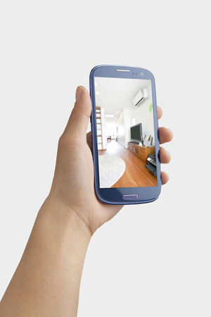 multi family house: Hand with a Smartphone
