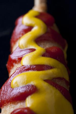 high calorie foods: Corn Dog Stock Photo