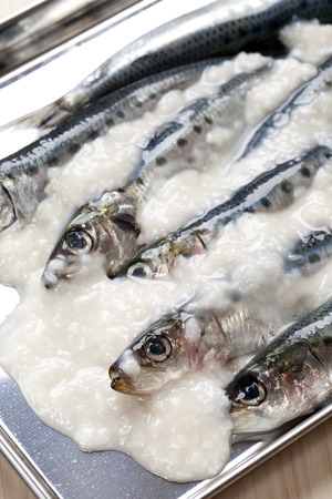 works: Fish dishes using salt works Stock Photo